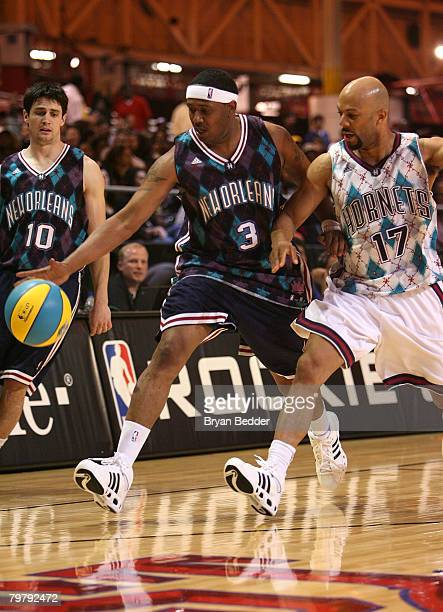Rapper Master P of the New Orleans team guarded by actor/rapper Common of the Hornets team during the McDonald's All-Star Celebrity Game at New...