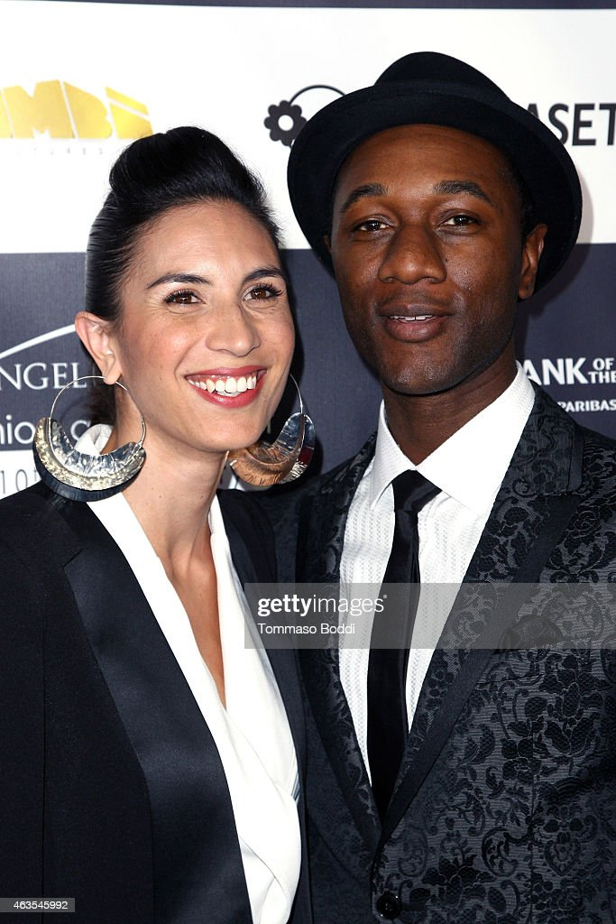 Rapper Maya Jupiter (L) and singer Aloe Blacc attend the Los Angeles Italia Opening Gala held at the TCL Chinese 6 Theatres on February 15, 2015 in Hollywood, California.