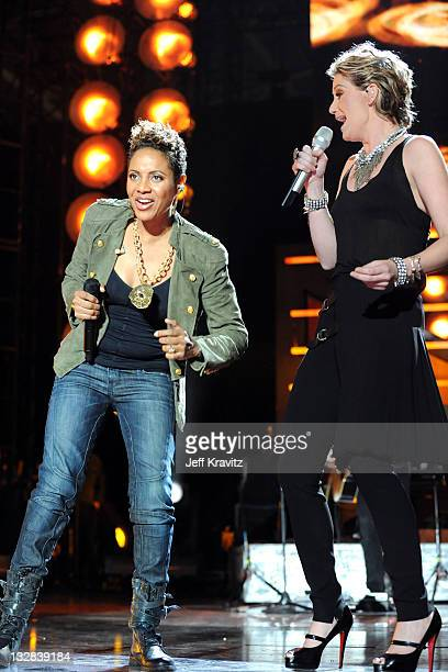 Rapper MC Lyte and musician Jennifer Nettles of Sugarland perform onstage during 'VH1 Divas Salute the Troops' presented by the USO at the MCAS...