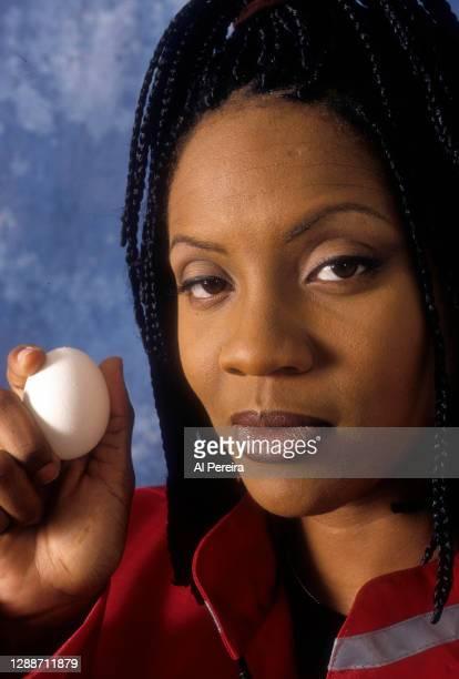 Rapper MC Lyte appears with an egg in a portrait taken on July 10, 1996 in New York City.