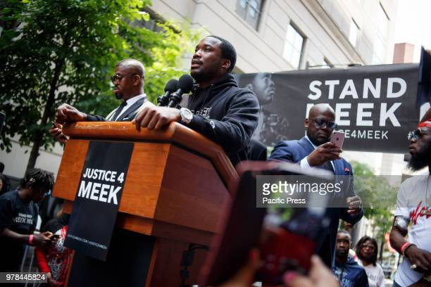 Rapper Meek Mill addresses a rally outside the courthouse where he returns today, continuing to seek a new trial on charges he's been fighting for a...