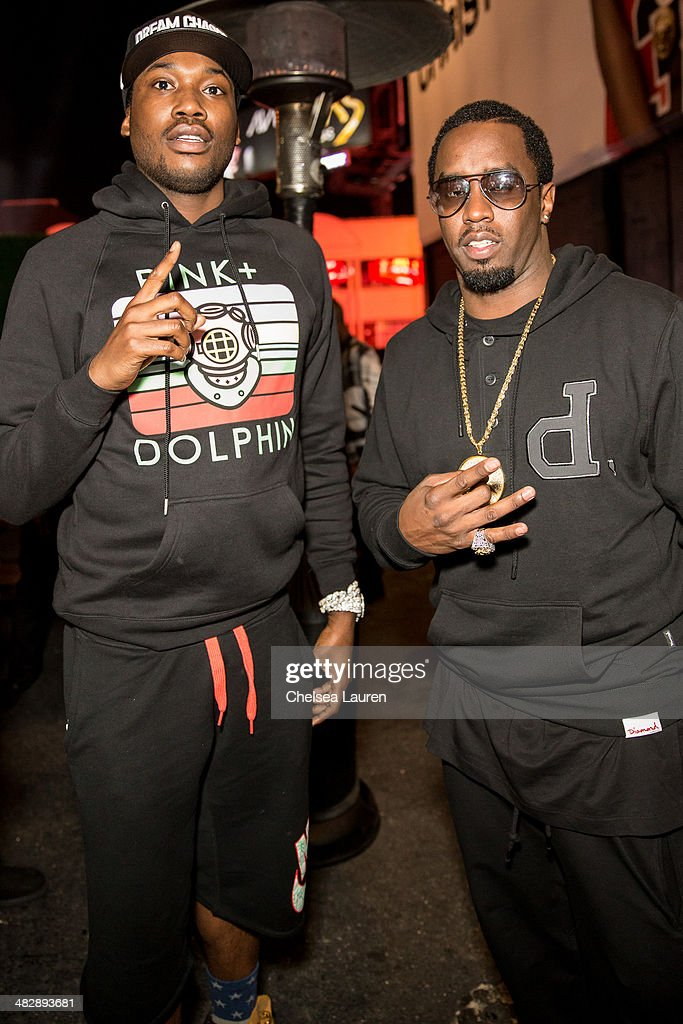 Rapper Meek Mill (L) and entertainment mogul Sean 'Diddy' Combs attend Christian Casey Combs' 16th birthday party at 1OAK on April 4, 2014 in West Hollywood, California.