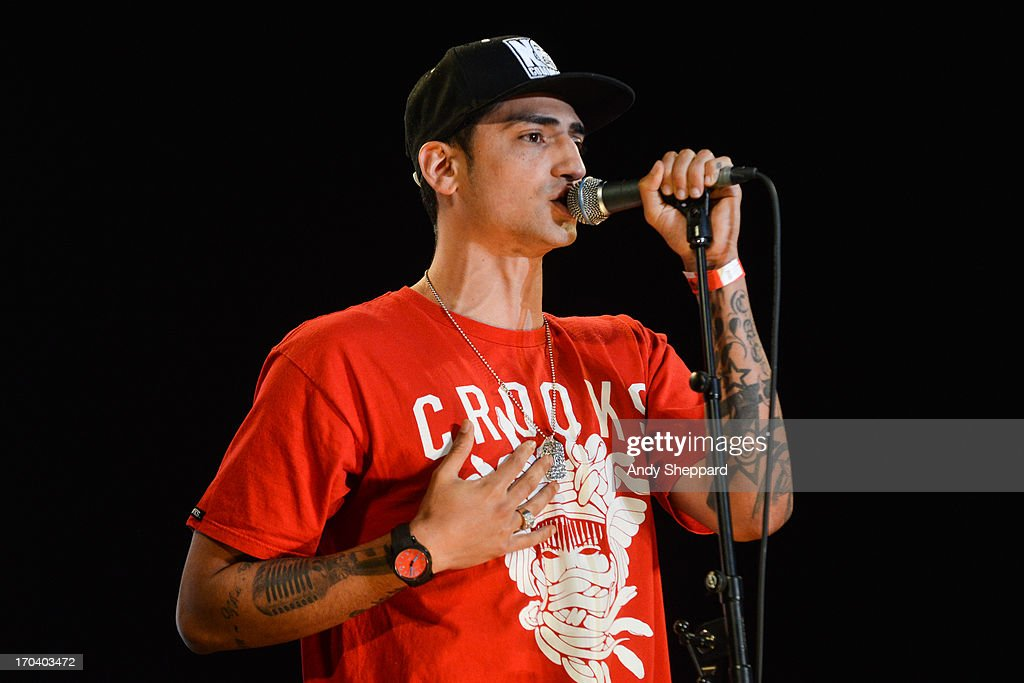 Rapper Mic Righteous performs on stage in support of One campaign's Agit8 event at Tate Modern on June 12, 2013 in London, England.