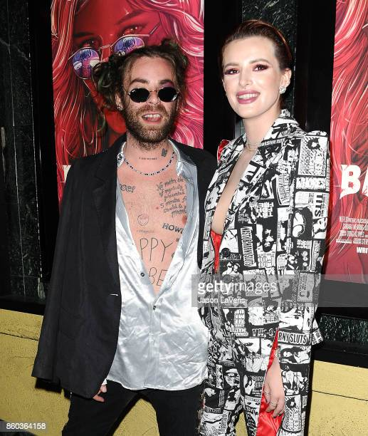 Rapper Mod Sun and Actress Bella Thorne attend the premiere of 'The Babysitter' at the Vista Theatre on October 11 2017 in Los Angeles California