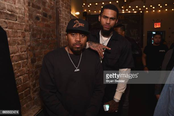 Rapper Nas and rapper Dave East attend the celebration of Tupac's Powamekka Cafe and preview of Tupac by Vlone on April 6 2017 in New York City