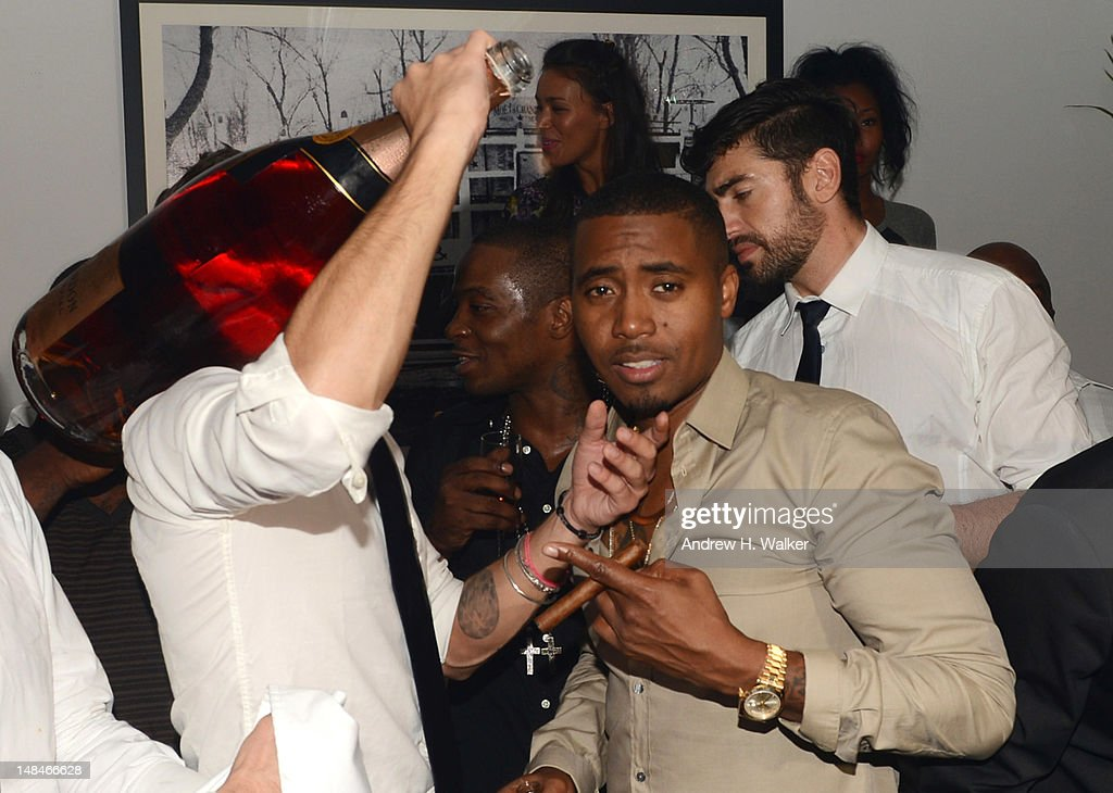 Rapper Nas (R) attends Moet Rose Lounge Presents Nas' Life Is Good at Bagatelle on July 16, 2012 in New York City.