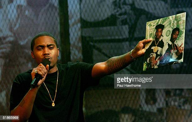 Rapper Nas pays tribute to old school rap group Eric B and Rakim as he performs onstage during MTV's taping of 'Life and Rhymes of Nas' at the Bowery...