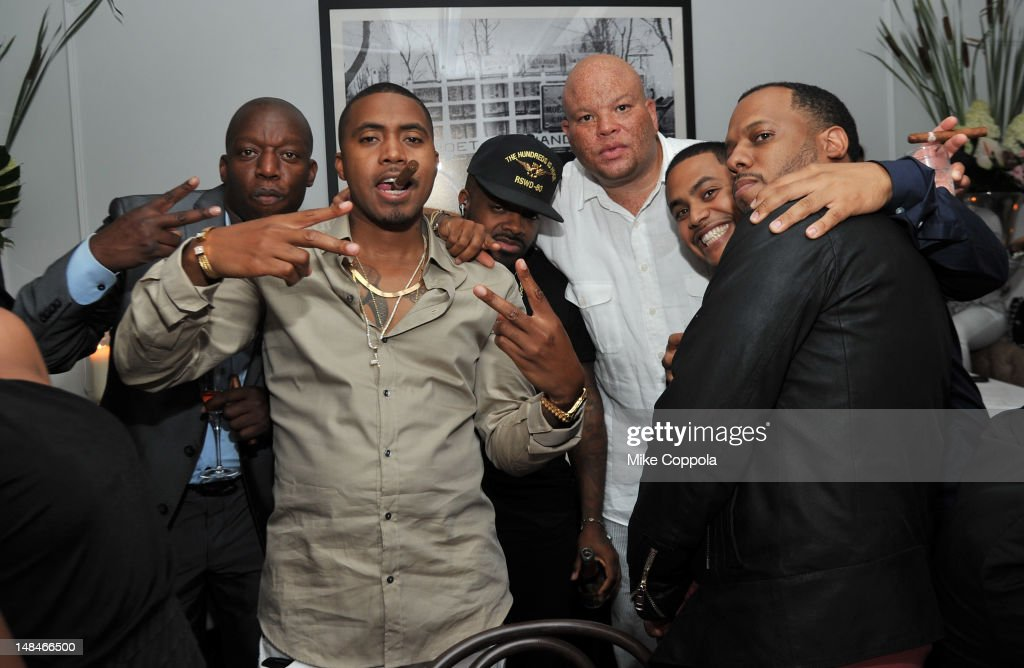 Rapper Nas, producer Jermaine Dupri, Senior VP of Island/Def Jam Shawn 'Pecas' Costner, guest, and producer No I.D. attend Moet Rose Lounge Presents Nas' Life Is Good at Bagatelle on July 16, 2012 in New York City.