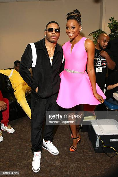Rapper Nelly and Actress Erica Ash attends the BET Hip Hop Awards 2014 presented by Sprite at Boisfeuillet Jones Atlanta Civic Center on September 20...