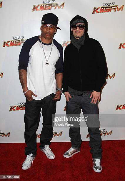 Rapper Nelly and Avery Storm arrive at 1027 KIIS FM's Jingle Ball 2010 at Nokia Theater LA Live on December 5 2010 in Los Angeles California