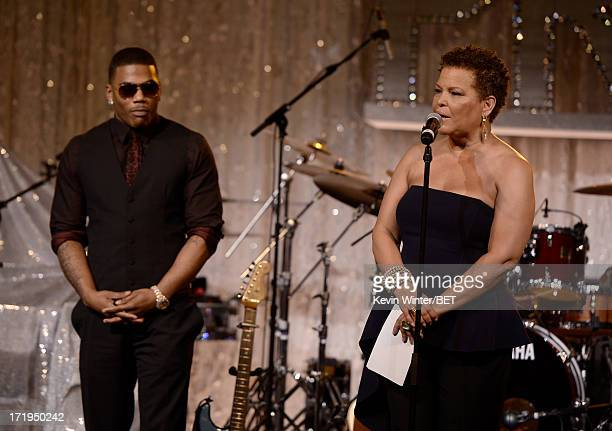Rapper Nelly and Chairman and CEO of BET Networks Debra Lee speak onstage at Debra Lee's Pre-BET Awards Celebration Dinner at Milk Studios on June...