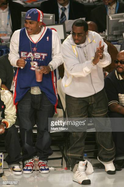 Rapper Nelly and Sean 'P Diddy' Combs attend the 2005 NBA All Star Game at the Pepsi Center on February 20 2005 in Denver Colorado