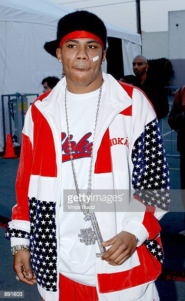 Rapper Nelly attends the 29th Annual American Music Awards at the Shrine Auditorium January 9 2002 in Los Angeles CA