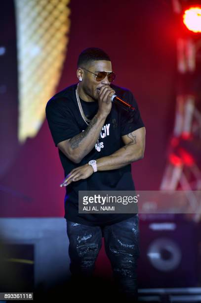 US rapper Nelly performs on stage during a maleonly concert at King Abdullah Economic City on December 14 2017