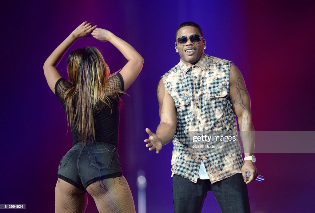 Rapper Nelly (R) performs onstage at Honda Center on September 7, 2017 in Anaheim, California.