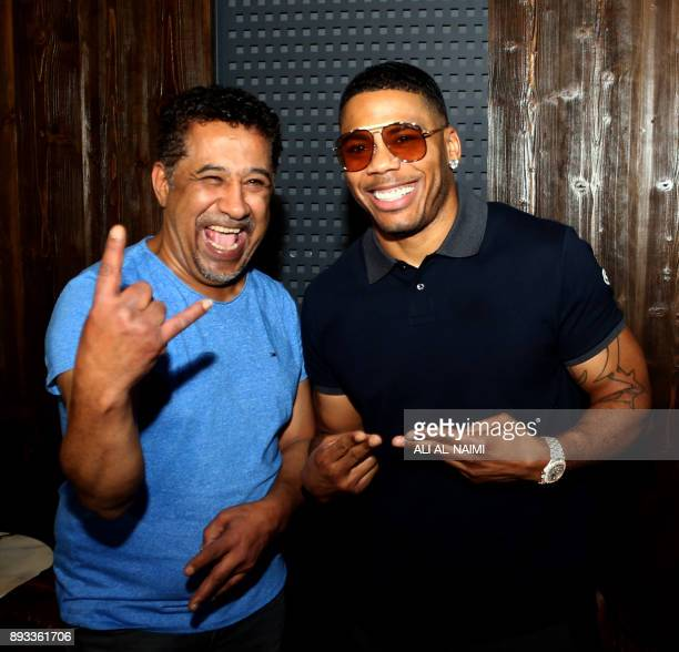 US rapper Nelly poses for a picture with Algerian Rai singer Khaled ahead of their maleonly concert at King Abdullah Economic City on December 14...