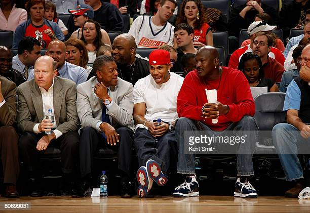 Rapper Nelly shares a laugh with Charlotte Bobcats Owner and Managing Member of Basketball Operations Michael Jordan during the Bobcats game against...