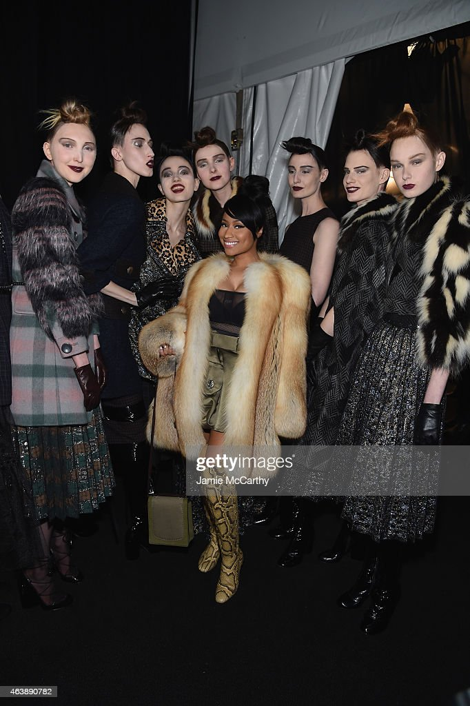 Rapper Nicki Minaj (C) and models pose backstage at the Marc Jacobs fashion show during Mercedes-Benz Fashion Week Fall 2015 at Park Avenue Armory on February 19, 2015 in New York City.