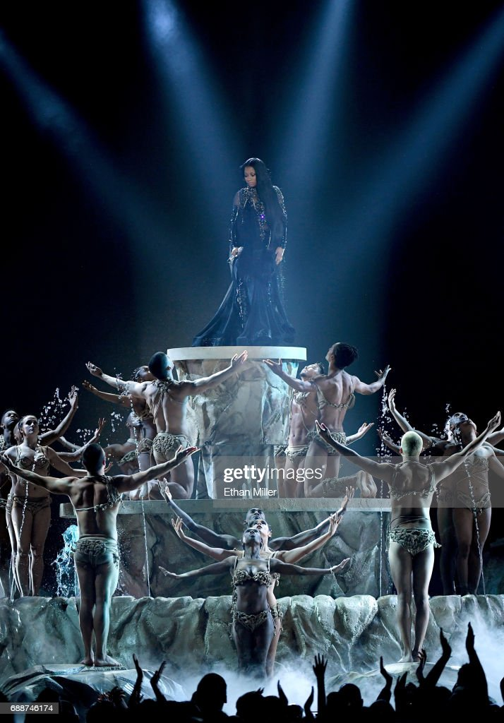 Rapper Nicki Minaj (top) performs with dancers during the 2017 Billboard Music Awards at T-Mobile Arena on May 21, 2017 in Las Vegas, Nevada.