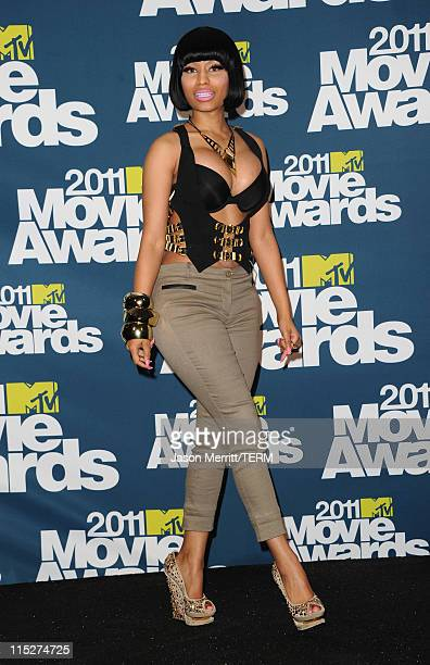 Rapper Nicki Minaj poses in the press room during the 2011 MTV Movie Awards at Universal Studios' Gibson Amphitheatre on June 5 2011 in Universal...
