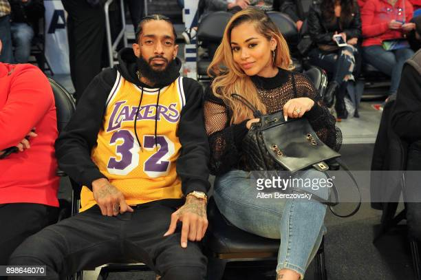 Rapper Nipsey Hussle and Lauren London attend a basketball game between the Los Angeles Lakers and the Minnesota Timberwolves at Staples Center on...