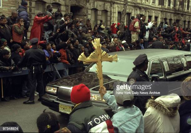 Rapper Notorious BIG aka Biggie Smalls aka Chris Wallace fans gather in Bedford Stuyvesant where the funeral car passed before going to the cemetery