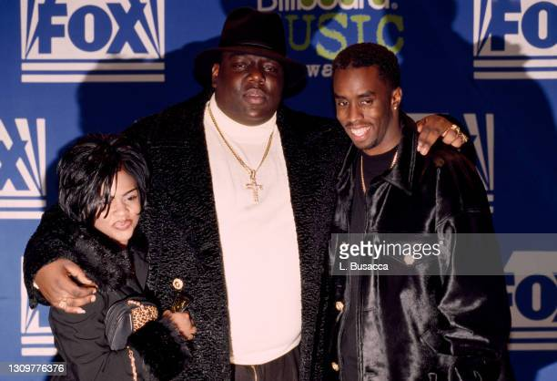 Rapper Notorious B.I.G. AKA Biggie Smalls joined by Sean Combs and Lil' Kim receives Billboard Music Award on December 6, 1995 at The Coliseum in New...