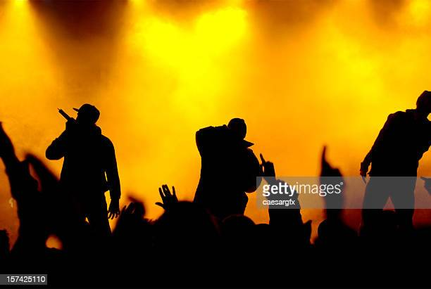 rapper on concert stage - hip hop music stock pictures, royalty-free photos & images