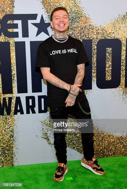Rapper Phora arrives at the BET Hip Hop Awards 2018 at Fillmore Miami Beach on October 6 2018 in Miami Beach Florida