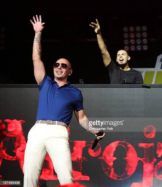 Rapper Pitbull and Afrojack perform onstage during KIIS FM's 2012 Jingle Ball at Nokia Theatre LA Live on December 3 2012 in Los Angeles California