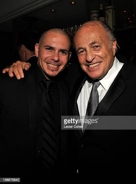 Rapper Pitbull and CEO of Sony Music Entertainment Doug Morris attend the Sony Music Group GRAMMY Reception 2012 held at Cecconi's West Hollywood on...