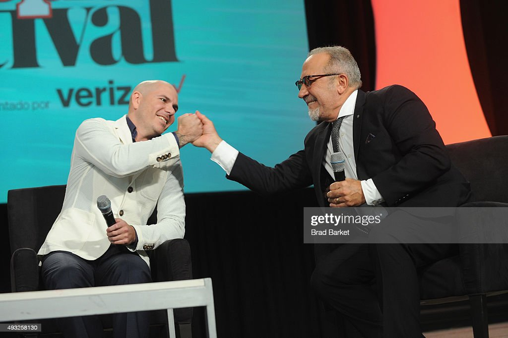 Rapper Pitbull (L) and musician Emilio Estefan speak onstage during Festival PEOPLE En Espanol 2015 presented by Verizon at Jacob Javitz Center on October 18, 2015 in New York City.