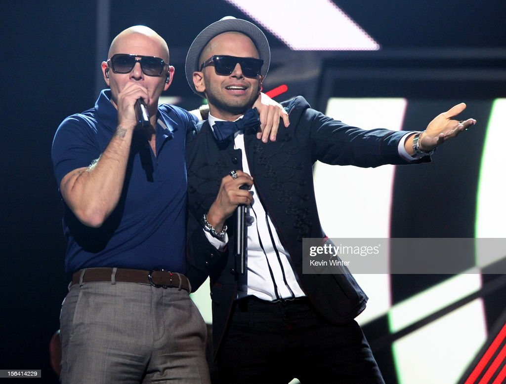 Rapper Pitbull (L) and singer Sensato perform onstage during rehearsals for the 13th annual Latin GRAMMY Awards at the Mandalay Bay Events Center on November 14, 2012 in Las Vegas, Nevada.