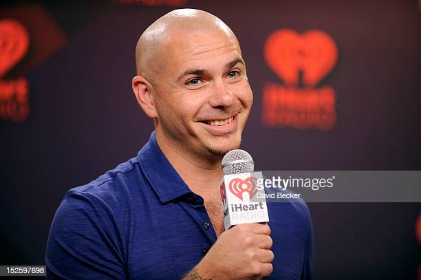 Rapper Pitbull interviews in the Elvis Duran Broadcast Room during the 2012 iHeartRadio Music Festival at the MGM Grand Garden Arena on September 22...