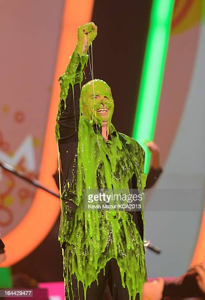 Rapper Pitbull performs during Nickelodeon's 26th Annual Kids' Choice Awards at USC Galen Center on March 23 2013 in Los Angeles California