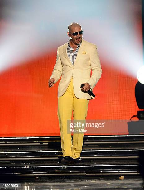 Rapper Pitbull performs onstage during the 2013 Billboard Music Awards at the MGM Grand Garden Arena on May 19 2013 in Las Vegas Nevada