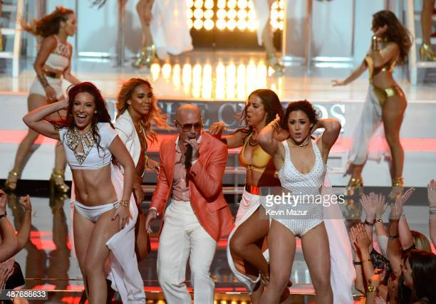Rapper Pitbull performs onstage during the 2014 iHeartRadio Music Awards held at The Shrine Auditorium on May 1 2014 in Los Angeles California...