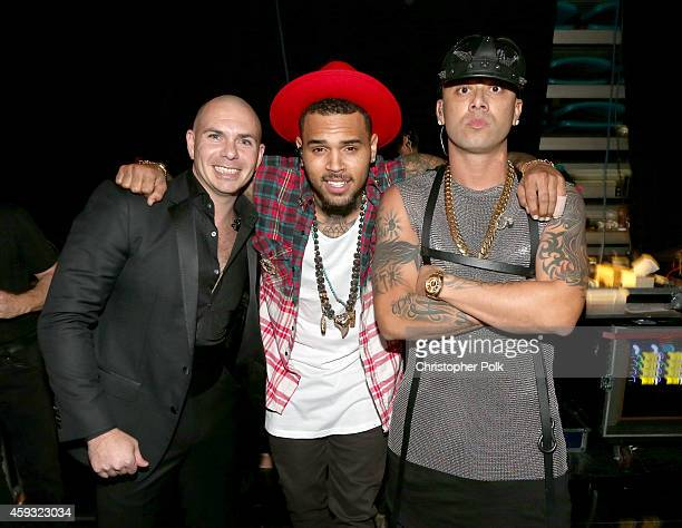 Rapper Pitbull singer Chris Brown and rapper Wisin attend the 15th Annual Latin GRAMMY Awards at the MGM Grand Garden Arena on November 20 2014 in...