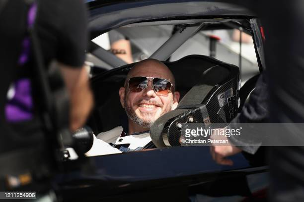 Rapper Pitbull sits in a car while filming a commercial spot during the NASCAR Cup Series FanShield 500 at Phoenix Raceway on March 08, 2020 in...