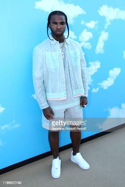 Rapper Pop Smoke attends the Louis Vuitton Menswear Fall/Winter 2020-2021 show as part of Paris Fashion Week on January 16, 2020 in Paris, France.