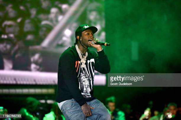 Rapper Pop Smoke performs onstage during day 2 of the Rolling Loud Festival at Banc of California Stadium on December 15 2019 in Los Angeles...