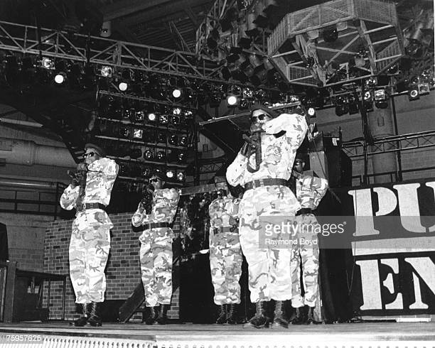 Members of the rap group 'Public Enemy's' security unit S1W perform onstage in 1988 in Chicago Illinois