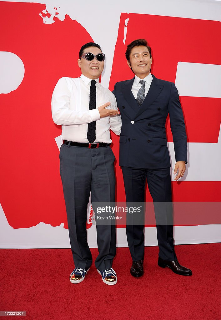 Rapper Psy (L) and actor Byung-hun Lee attend the premiere of Summit Entertainment's 'RED 2' at Westwood Village on July 11, 2013 in Los Angeles, California.
