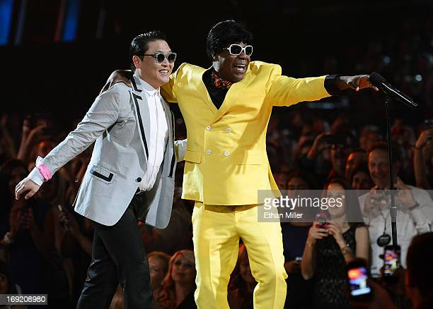 Rapper Psy and actor/comedian Tracy Morgan joke around at the 2013 Billboard Music Awards at the MGM Grand Garden Arena on May 19 2013 in Las Vegas...