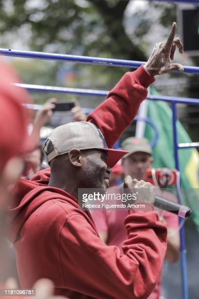 Rapper 'Rappin' Hood' speaks for Luiz Inacio Lula da Silva supporters before his official speech at the Sindicato dos Metalurgicos do ABC on November...