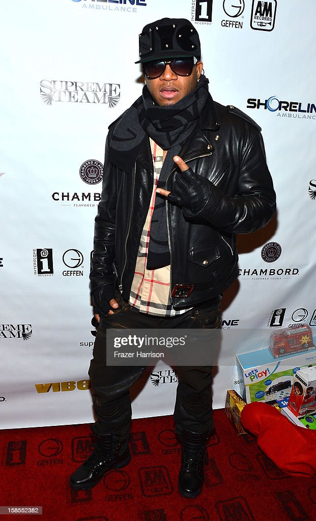 Rapper Redcafe arrives at Interscope Geffen A&M Promotions Department 9th Annual Holiday Party And Toy Drive at SupperClub Los Angeles on December 18, 2012 in Los Angeles, California.