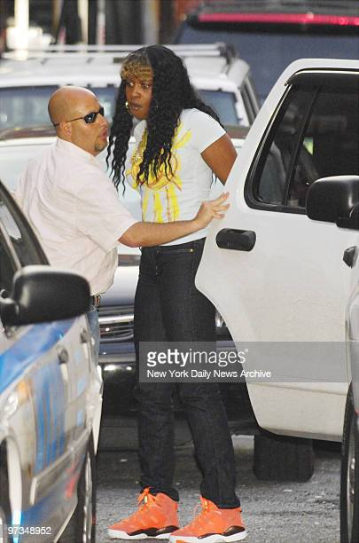 Rapper Remy Ma is escorted into the 6th Precinct stationhouse for questioning regarding the shooting of her close friend Makeda BarnesJoseph in the...