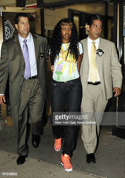 Rapper Remy Ma is escorted out of the sixth Precinct stationhouse after being questioned in the shooting of her close friend Makeda BarnesJoseph in...