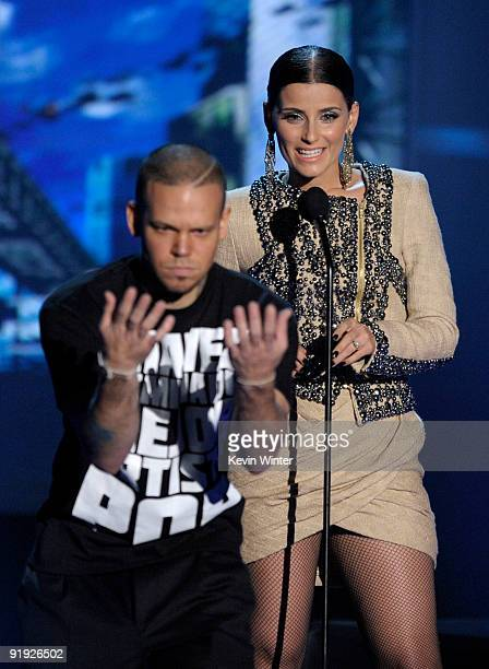 "Rapper Residente and singer Nelly Furtado speak onstage at the ""Los Premios MTV 2009"" Latin America Awards held at Gibson Amphitheatre on October 15,..."