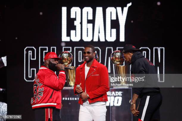 Rapper Rick Ross performs a song with Udonis Haslem and former Miami Heat player Dwyane Wade during the Miami Heat Dwyane Wade L3GACY Celebration at...